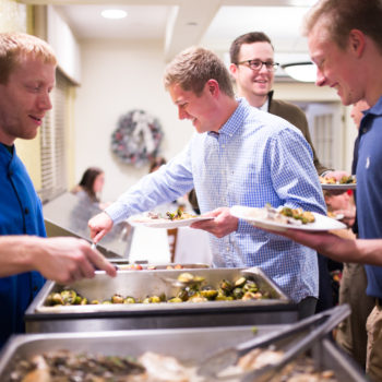 Greek House Chefs chef serving food to fraternity members